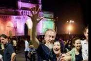Foriegn tourists celebrate at the Gateway of India