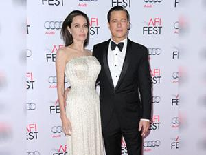 Angelina Jolie and Brad Pitt arrive at the 2015 AFI Fest