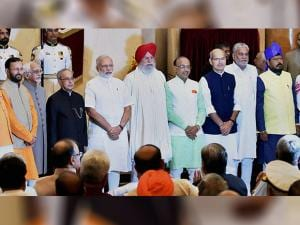 President Pranab Mukherjee, Vice President Hamid Ansari and Prime Minister Narendra Modi with the newly sworn-in ministers