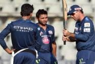 Mumbai Indians' players Unmukt Chand and Parthiv Patel with the team's head coach Ricky Ponting