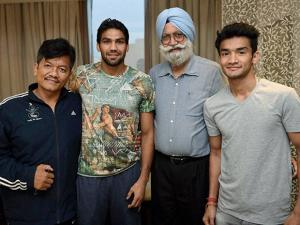 Indian boxers Manoj Kumar and Shiva Thapa with their coach Gurbaksh Singh Sandhu and Shiva's father Padam Thapa (L) in New Delhi