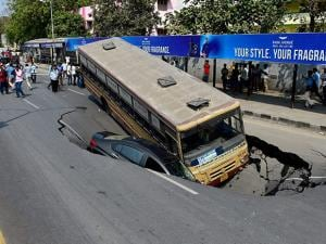 huge crater formed after a portion of the road caved in at the arterial Anna Salai in Chennai