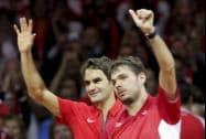 Roger Federer and compatriot  Stanislas Wawrinka wave after defeating