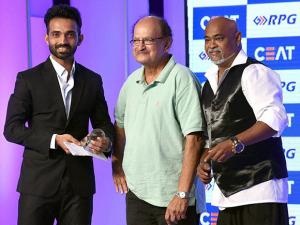Former Indian cricketers Ajit Wadekar and Vinod Kambli present the CEAT Cricket Rating special award to Indian cricketer Ajinkya Rahane in Mumbai