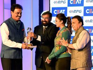 Industrialist Harsh Goenka, bollywood actress Huma Qureshi and former cricketer Sunil Gavaskar present the life time achievment CEAT Cricket Rating award to former Indian cricketer Dilip Vengsarkar in Mumbai