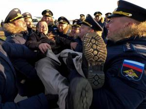A pilot is greeted after returning from Syria during a welcome ceremony at a Russian air base in Primorsko-Akhtarsk, southern Russia