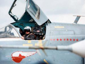 a pilot of Russian Su-24 bomber gets ready for  take off at Hemeimeem air base in Syria