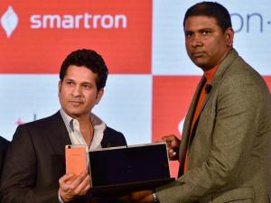 Cricket legend Sachin Tendulkar with Founder and Chairman, Mahesh Lingareddy unveils the Ultrabook convertible t.book & premium smartphone t.phone at a function in New Delhi