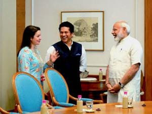 Prime Minister Narendra Modi with cricket legend Sachin Tendulkar and his wife Anjali