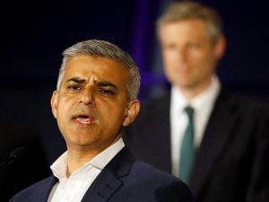 Sadiq Khan, Labour Party candidate, speaks in front of Zac Goldsmith, Conservative Party candidate, after winning the London mayoral elections, at City Hall in London