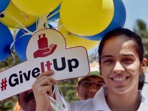 shuttler Saina Nehwal holding balloons during an LPG subsidy give-up event, in Bengaluru