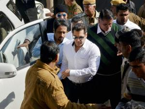 Salman Khan, walks through a crowd outside the court