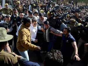 Salman Khan, walks through a crowd outside the court, has been acquitted in 1998 Arms Act case by Jodhpur court, in Jodhpur