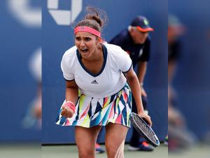 Sania Mirza, of India, reacts after a shot against doubles opponents