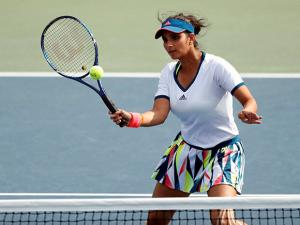 Sania Mirza, of India, returns a shot during a women's doubles match
