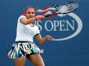 Sania Mirza, of India, returns a shot during the second round of women's double