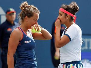 Sania Mirza, of India, right, talks with doubles partner Barbora Strycova Czech Republic