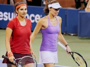 Martina Hingis of Switzerland and partner Sania Mirza, of India