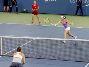 Sania Mirza looks on as her partner Martina Hingis returns