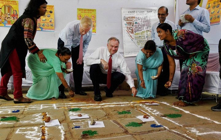 U.S., Sen. Angus King, (I-Maine), Tim Kaine, making, rangoli, women, children, Sanjay Gandhi, J.J., Cluster shanty town, overview, sanitation, programs, run, non-governmental organizations, New Delhi