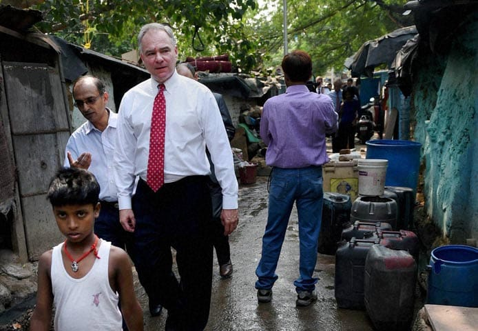 U.S. Sen., Tim Kaine, walks, Sanjay Gandhi J.J., Cluster shanty town, overview, sanitation, programs, run, non-governmental, organizations, New Delhi