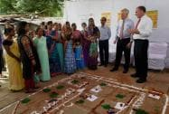 U.S. Sen. Angus King (I-Maine) and Tim Kaine making rangoli with women and children