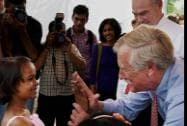 U.S. Sen. Angus King (I-Maine) teaches high-five to an Indian girl