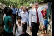 US Senators Tim Kaine (D-Va) and Angus King  walk at Sanjay Gandhi J.J. Cluster shanty town