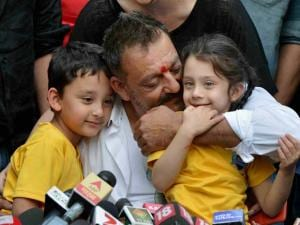 anjay Dutt with his wife Manyata and children Shahran and Iqra in a press_conference at his residence in Mumbai