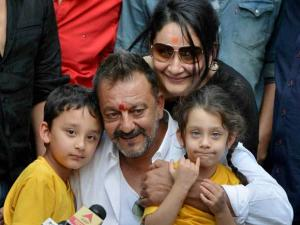 Sanjay Dutt with his wife Manyata and children Shahran and Iqra in a press conference at his residence in Mumbai