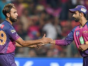 Rising Pune Supergiants bowler Imran Tahir celebrates the wicket of Delhi Daredevils batsman Sam Billings