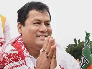 BJP chief ministerial candidate Sarbananda Sonowal greets supporters at a victory procession after the party's thumping win the Assam Assembly polls 2