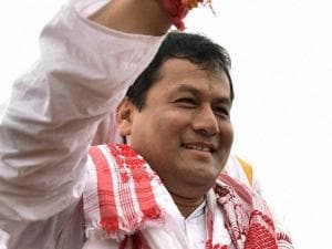 BJP chief ministerial candidate Sarbananda Sonowal waves to supporters at a victory procession after the party's thumping win the Assam Assembly polls, in Guwahati
