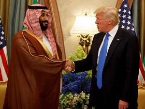 President Donald Trump shakes hands with Saudi Deputy Crown Prince and Defense Minister Mohammed bin Salman