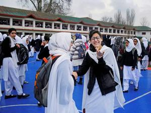 Students assemble for prayer in a school in Srinagar