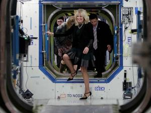 Vice President Joe Biden's wife Jill Biden walks inside a mockup of the International Space Station during a tour of NASA's Johnson Space Center in Houston
