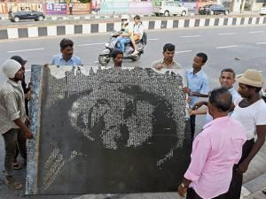 Sachin Tendulkar's sculpture which was installed at the marine drive as a tribute to the former cricketer is being removed by laborers after the High Court's order in Mumbai