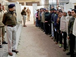 Police personnel guarding a polling station in Saharanpur