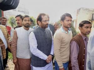Union Minister Mukhtar Abbas Naqvi stand in line to cast his vote during the second phase of UP assembly elections in Rampur