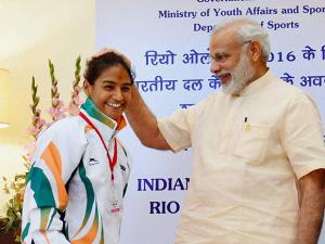 A hockey player being blessed by Prime Minister Narendra Modi at a warm send-off ceremony