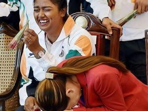 Archer Deepika Kumari sharing light moments with boxer Mary Kom at a warm send-off ceremony