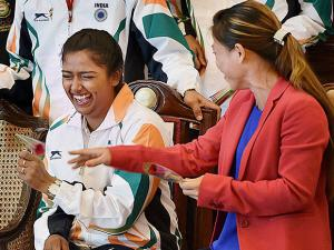 Archer Deepika Kumari sharing light moments with boxer Mary Kom at a warm send-off ceremony organised