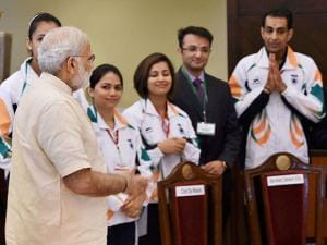 Narendra Modi interacts with the athletes and sportspersons during a warm send-off