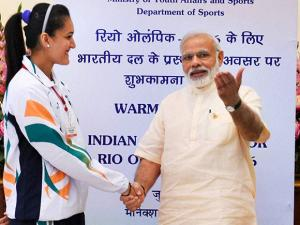 Prime Minister Narendra Modi shakes hand with Table Tennis player Manika Batra during the warm send-off  ceremony