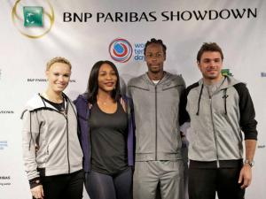 Tennis players Caroline Wozniacki, Serena Williams, second from left, Gael Monfils, second from right, and Stan Wawrinka pose for a picture during a news conference