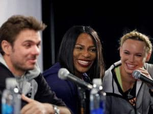 Tennis players Stan Wawrinka, left, Serena Williams, center, and Caroline Wozniacki laugh at a reporters question during a news conference