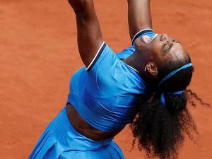 Serena Williams of the U.S. celebrates winning the third round match of the French Open tennis tournament against France's Kristina Mladenovic at the Roland Garros stadium in Paris, France