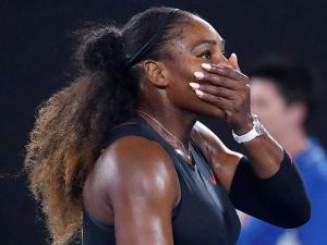 Serena Williams covers her face after defeating her sister, Venus, in the women's singles final at the Australian Open tennis championships