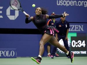 serena williams reaches for a forehand rturn to simona halep