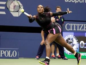 Serena Williams, of the United States, reaches for a forehand rturn to Simona Halep